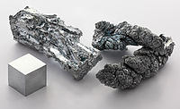 Zinc fragment sublimed and 1cm3 cube.jpg
